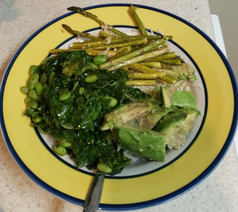 Vegan Spring bowl with sautéed greens, asparagus, avocado, edamame, and rice