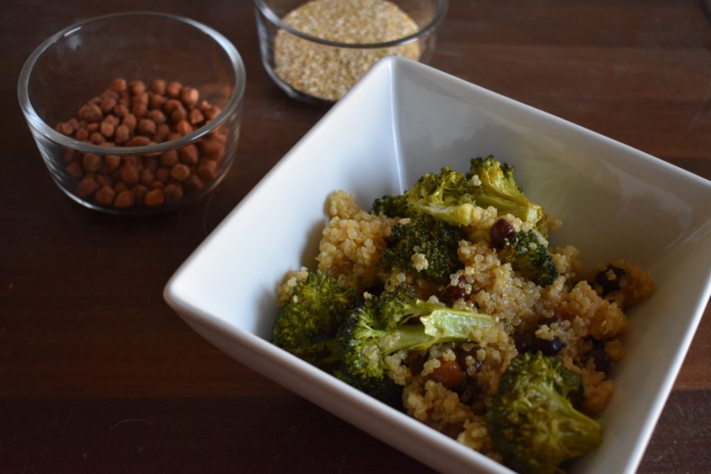 Closeup bowl of Roasted Broccoli and Chickpeas with quinoa salad bowl