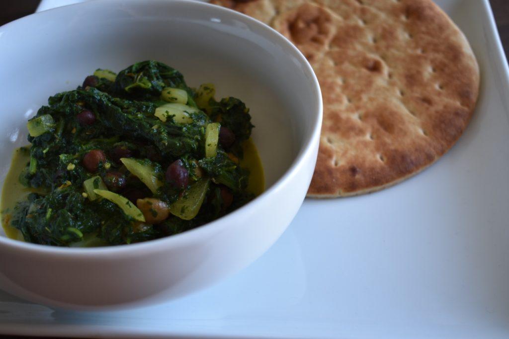Bowl of chana palak with side pita