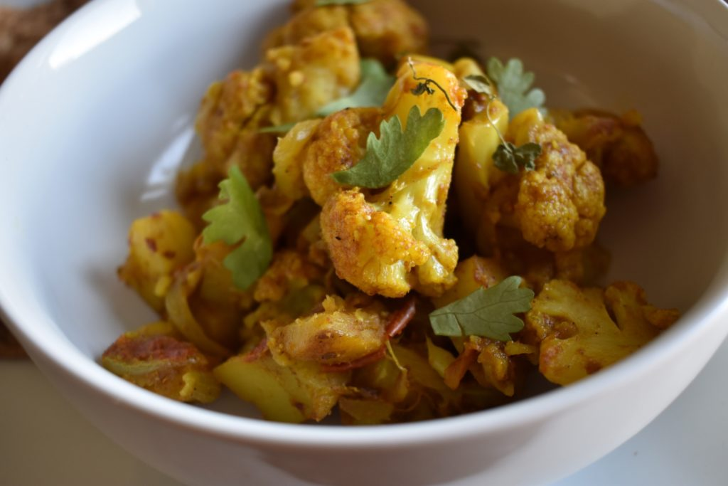 Bowl of aloo gobi a north Indian curried cauliflower and potato dish