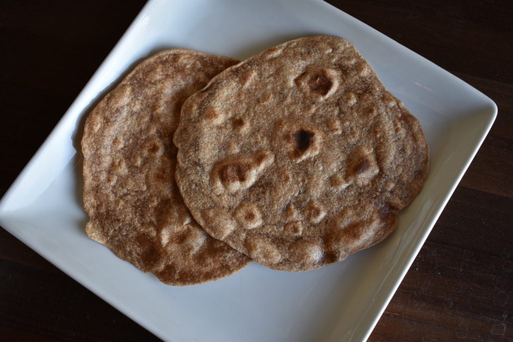 Two roti/chapati Indian style flatbread on a plate
