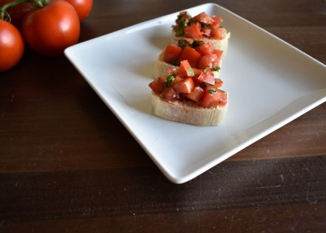 Closeup side view of tomato basil bruschetta on baguettes