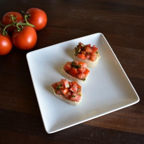 Three tomato basil bruschetta on toasted baguette