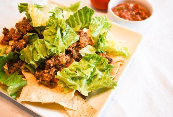 Plate of Quinoa Black Bean Taco filling nachos with salsa