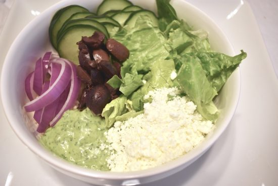 Vegetarian Mediterranean Buddha Bowl with Fresh Vegetables and Yogurt Sauce