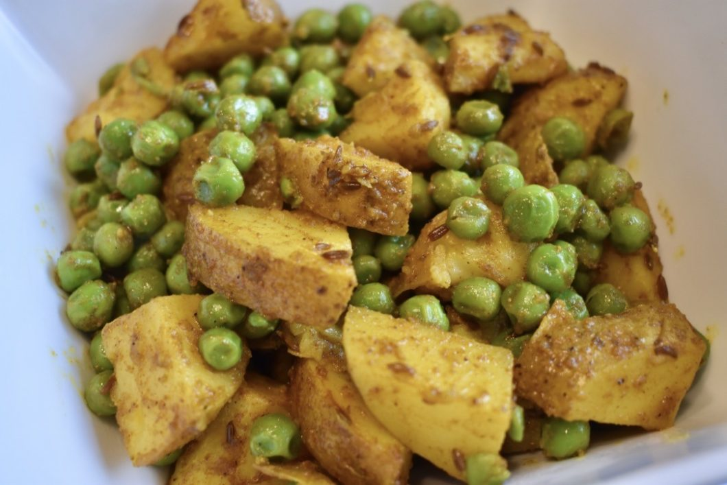 Closeup of Aloo Mutter Indian Curried Potatoes and Peas